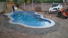 a fibreglass pool just installed. Dug on Thursday, swimming Friday (frigid tho!)
